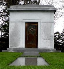cemetery(0.0), headstone(0.0), grave(0.0), chapel(0.0), statue(0.0), monument(1.0), mausoleum(1.0),
