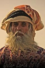 Old man wearing Arab dress HDR by Qatar Earth 2010