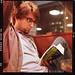 M. from Ottawa, reading a book in Smoke's Poutinerie. Toronto.   Shot on Ektar 100