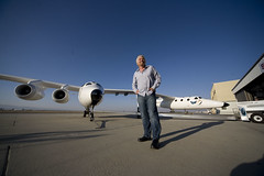 Sir Richard Branson stands before VMS Eve, Mojave, July 08. Credit Ned RocknRoll