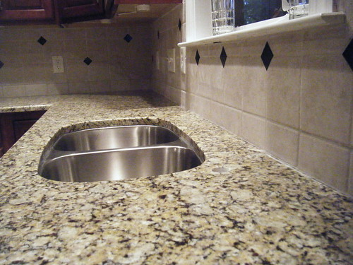 Granite Installation, Santa Cecilia Countertop, and Tile Backsplash Design