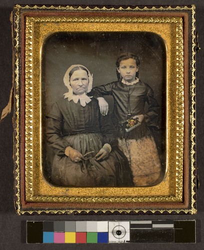 Portrait of unidentified older woman and girl
