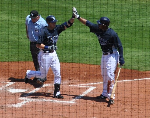 Evan Longoria Receives High Five from Carl Crawford April 1, 2010 Charlotte Sports Park, Fla.