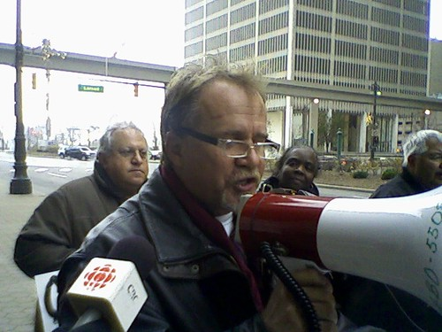 Canadian Auto Worker local 195 President Gerry Farnham speaks in front of Comerica Bank on November 24, 2009 in downtown Detroit. The workers have been battling for severance pay which is being held u