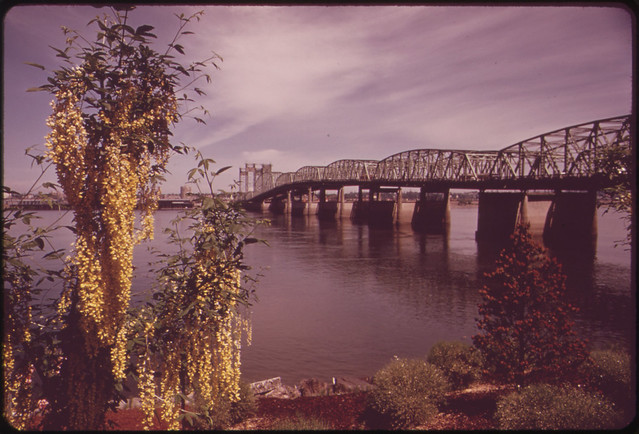 DOCUMERICA: The Interstate Bridge Which Connects Portland and Vancouver, Washington, Is the Only Columbia River Crossing for 50 Miles 05/1973 by David Falconer.
