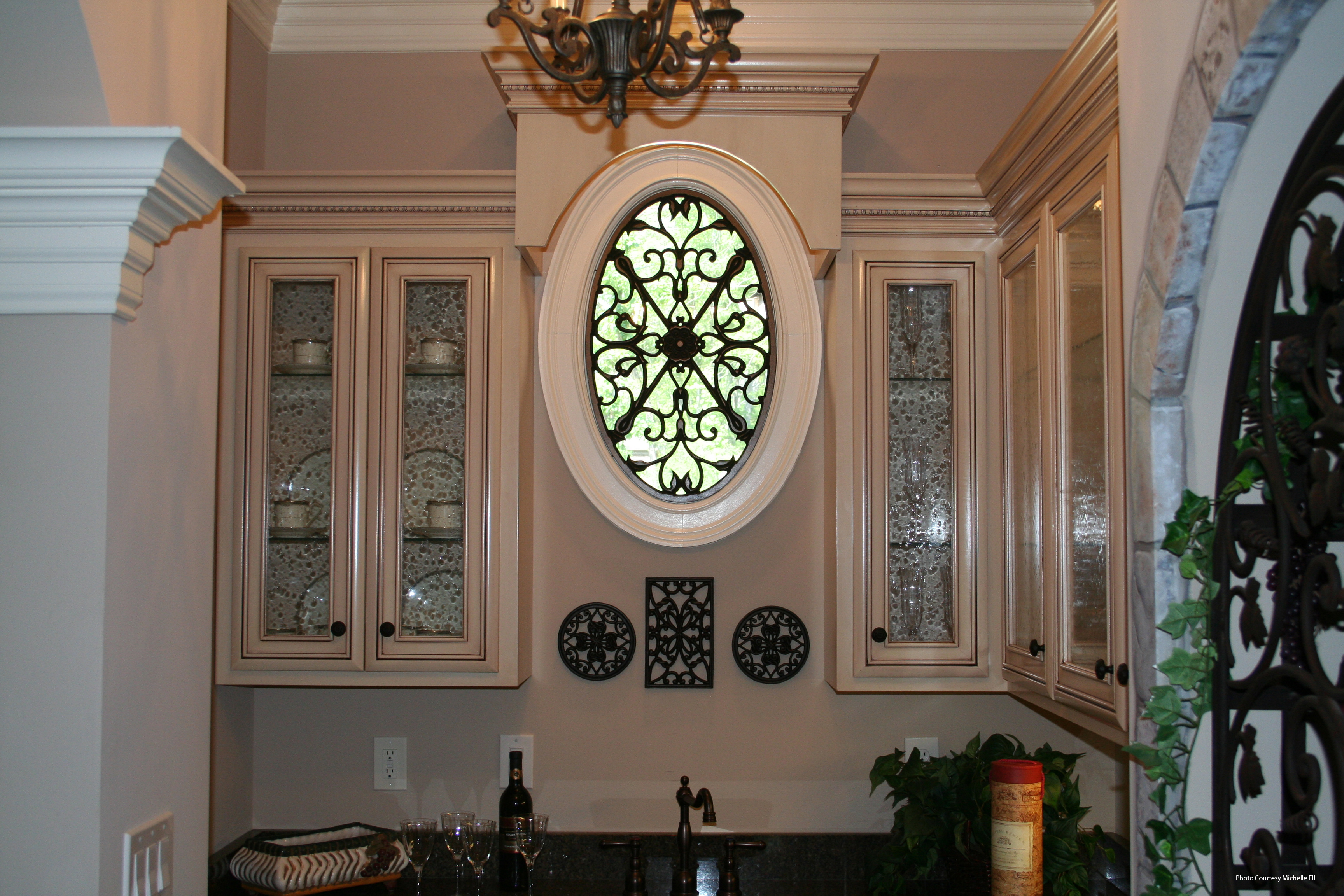 Faux wrought iron oval window treatment flickr photo for Window treatment for oval window