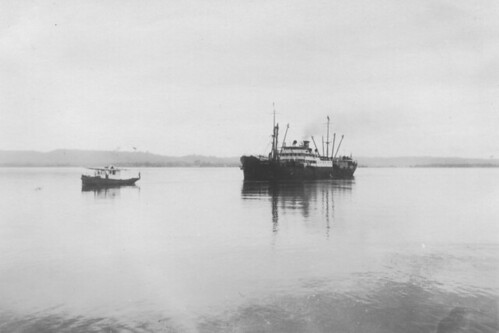 Lake Ormoc being towed into the dock by the tugboat Santarem, Fordlandia, ca. 1930.
