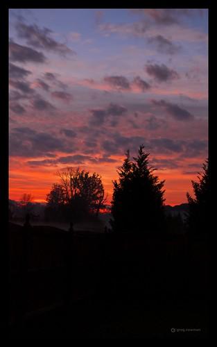 blue red orange contrast sunrise charlotte northcarolina clounds