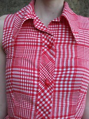 dress shirt(0.0), sleeve(0.0), maroon(0.0), outerwear(0.0), design(0.0), textile(1.0), clothing(1.0), collar(1.0), blouse(1.0), shirt(1.0), pink(1.0), plaid(1.0),