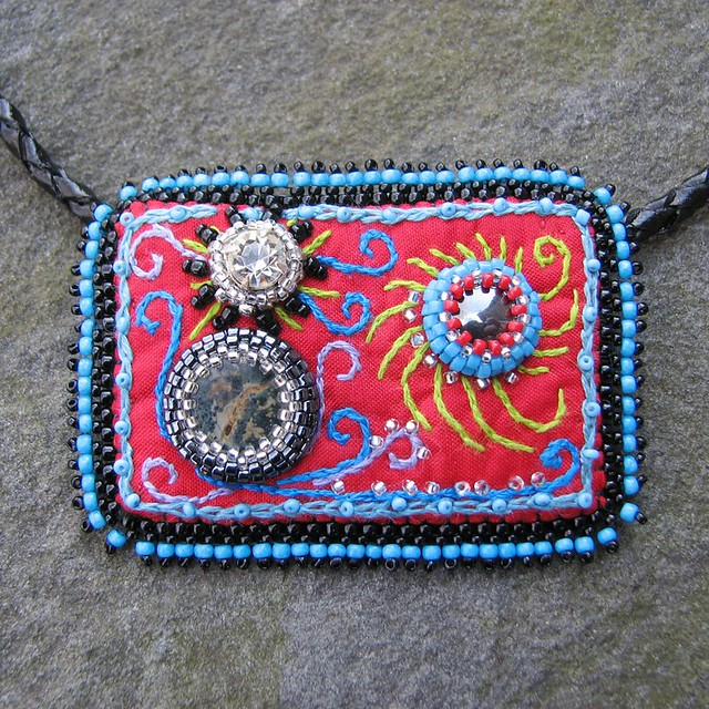 Bead embroidered pendant strange universe on leather and