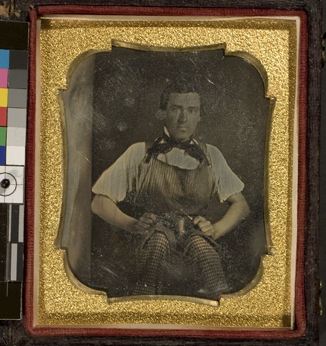 Portrait of unidentified man holding tool