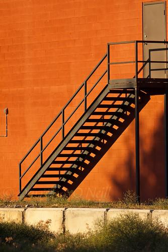 sunset goldenhour wall concrete block stairs metal industrial industry door orange grey gray green kelowna bc canada okanagan cement