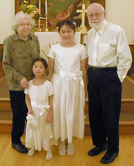 Mom, Dad, and Girls at First Communion