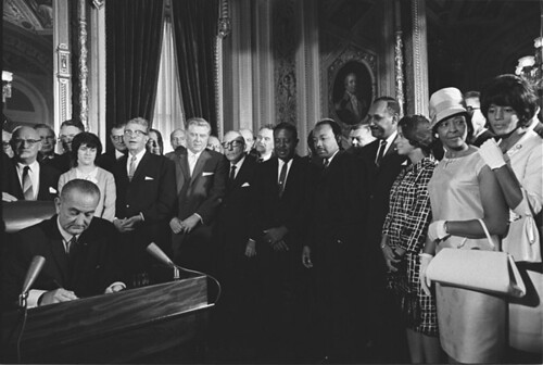 Photograph of President Lyndon Johnson Signs the Voting Rights Act as Martin Luther King, Jr., with Other Civil Rights Leaders in the Capitol Rotunda, Washington, DC, 08/06/1965