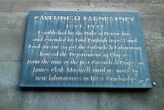 Photo of William Cavendish, James Clerk Maxwell, and John William Strutt black plaque