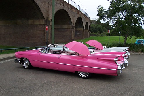 Pink and White Cadillac convertibles 1959
