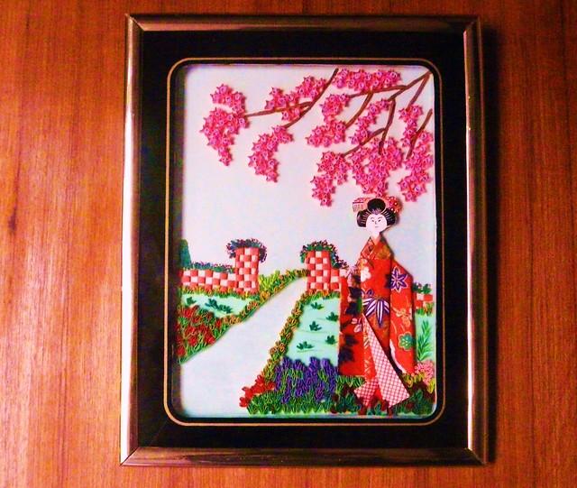 Geisha under cherry blossom tree