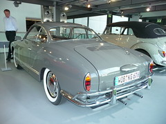 automobile(1.0), automotive exterior(1.0), vehicle(1.0), automotive design(1.0), compact car(1.0), antique car(1.0), sedan(1.0), classic car(1.0), land vehicle(1.0), volkswagen karmann ghia(1.0), luxury vehicle(1.0), sports car(1.0), motor vehicle(1.0),