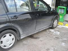 toyota vitz(0.0), compact car(0.0), bumper(0.0), automobile(1.0), automotive exterior(1.0), wheel(1.0), vehicle(1.0), nissan tiida(1.0), rim(1.0), subcompact car(1.0), city car(1.0), land vehicle(1.0),