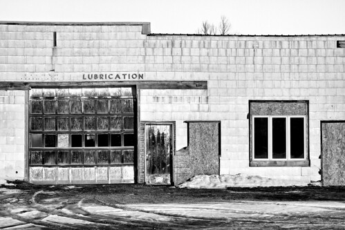 architecture blackandwhite building chippewacounty clapboard derelict fujixt1 garage lubrication m48 m129 michigan niksilverefex pickford pickfordtownship sky sunny unitedstates upperpeninsula winter xf1855mm