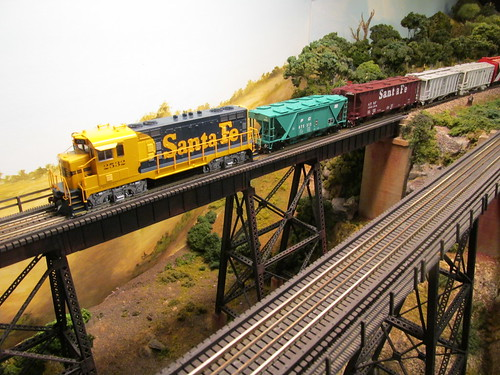 An ariel view of a 1970's era Santa Fe local freight train crossing the tall steel trestle. by Eddie from Chicago