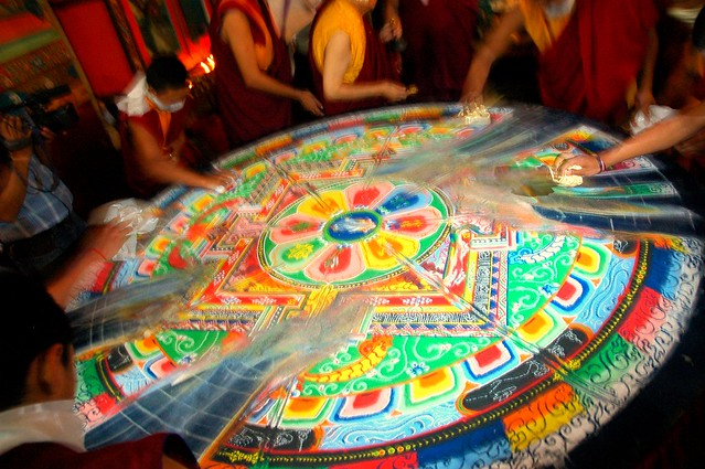 Monks sweeping away the colored sand mandala of Shri Hevajra, Tharlam Monastery of Tibetan Buddhism, Boudha, Kathmandu, Nepal