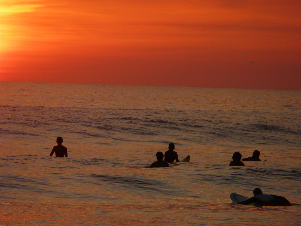 Surfers at Sunset on Dominicalito Beach