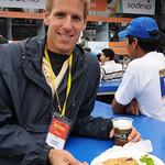 Enjoying a Rich Plate of Aji de Langoustina - Mistura Gastronomy Festival in Lima, Peru