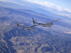 VMS Eve soars over the Mojave landscape a test flight. Credit Scherer