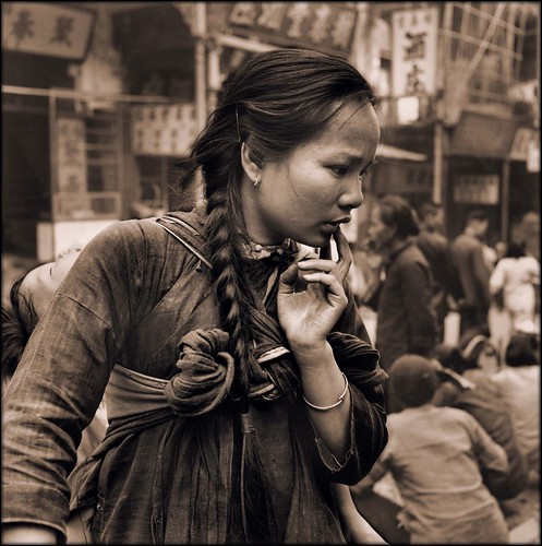 Young Mother Carrying A Child On Her Back In The Market, Hong Kong Island [c1946] Hedda Morrison [RESTORED]