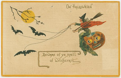 vintage illustration of witch riding a pumpking drawn by bats