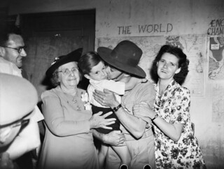 Albert Donovan is welcomed home by his wife and family, 1944