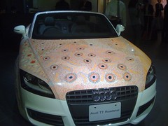 wheel(0.0), rim(0.0), automobile(1.0), automotive exterior(1.0), audi(1.0), executive car(1.0), vehicle(1.0), automotive design(1.0), audi tt(1.0), bumper(1.0), land vehicle(1.0), luxury vehicle(1.0), supercar(1.0),