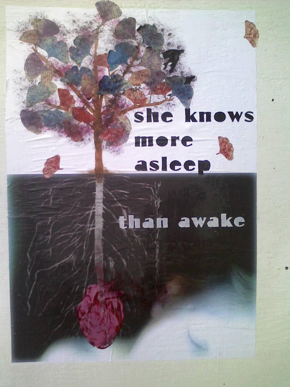 "street art of a tree growing out of a heart next to the words, ""she knows more asleep than awake"""
