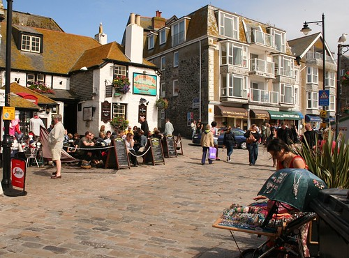 Sloop Inn and street seller, St.Ives, Cornwall by Stocker Images