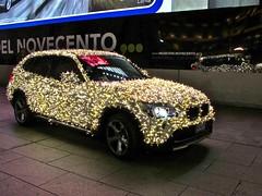 exhibition(0.0), executive car(0.0), sports sedan(0.0), auto show(0.0), sedan(0.0), sports car(0.0), automobile(1.0), wheel(1.0), vehicle(1.0), automotive design(1.0), bmw x1(1.0), land vehicle(1.0), luxury vehicle(1.0),