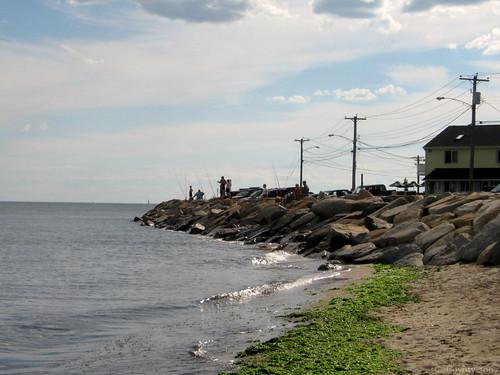 Seawall fishermen by Coyoty