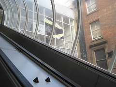 vehicle(0.0), iron(0.0), balcony(0.0), daylighting(1.0), window(1.0), handrail(1.0), architecture(1.0), glass(1.0), window covering(1.0), interior design(1.0), escalator(1.0), facade(1.0),
