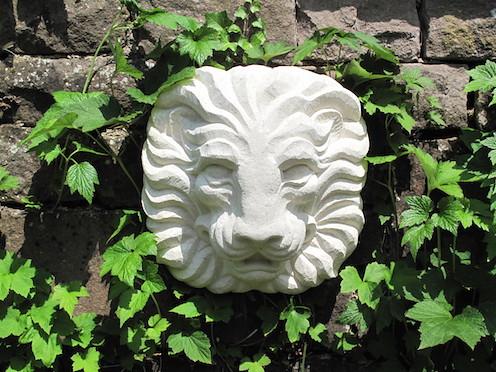 Hand carved limestone.