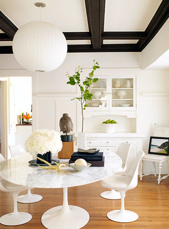 Modern white dining room: Saarinen Tulip table + chairs + 'Snow White' by Benjamin Moore