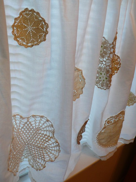 White curtains with doily appleque