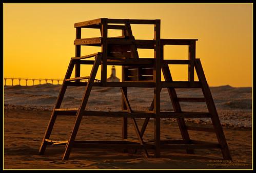 wood winter sunset usa brown lighthouse white snow ice beach yellow canon eos gold sand unitedstates indiana lakemichigan february 2010 lifeguardtower washingtonpark michigancity ef24105mmf4lisusm 5dmkii craigsorenson 20100303050158est