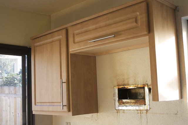 Kitchen Cabinets And Countertopsandtile Floors Inmediumtan