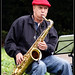 Sax player in red hat