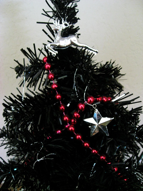 Black Christmas Tree With Silver And Red Ornaments