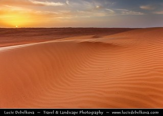 Oman - Sunset over Sea of Sand Dunes in Wahiba Sands