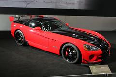 muscle car(0.0), race car(1.0), automobile(1.0), automotive exterior(1.0), wheel(1.0), vehicle(1.0), performance car(1.0), automotive design(1.0), auto show(1.0), concept car(1.0), land vehicle(1.0), srt viper(1.0), supercar(1.0), sports car(1.0),