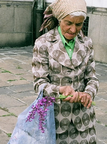 A Romanian elderly woman selling flowers