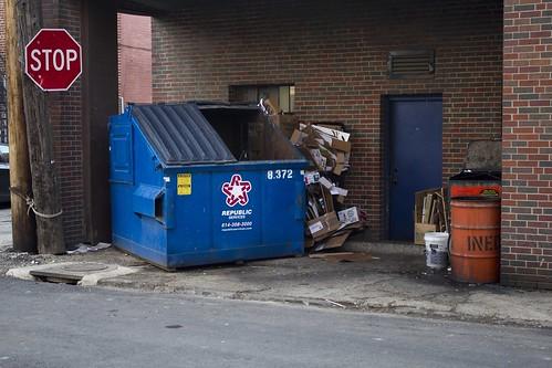 trash chrispackart photography dumpster stop sign back alley street city sidewalk landscape
