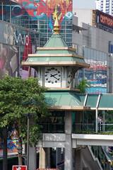 Clock tower as part of a pedestrian bridge near Central World in Bangkok